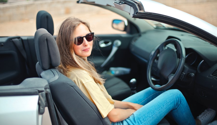 woman driving with sunglasses